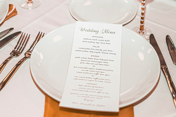 wedding menu on top of white plate