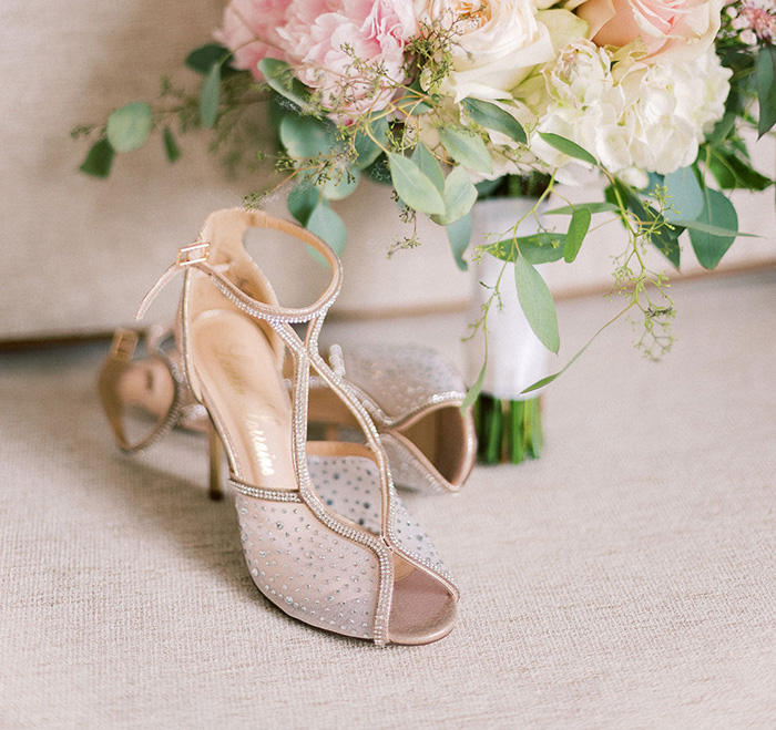 bride's shoes and pink bouquet