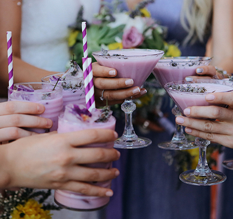 bridal party drinking fun purple cocktails