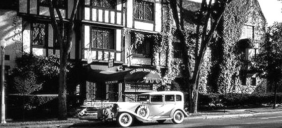 historic photo of a car outside of the deer path inn