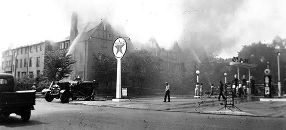 historic photos of firemen putting out a fire at the deer path inn