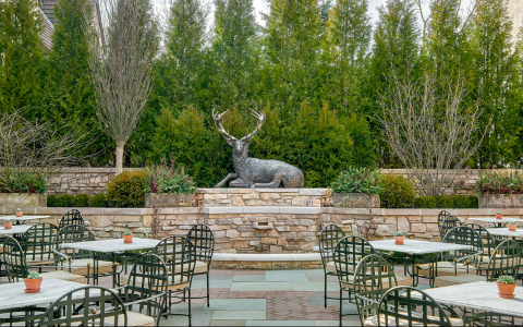 outdoor seating with a statue of a deer