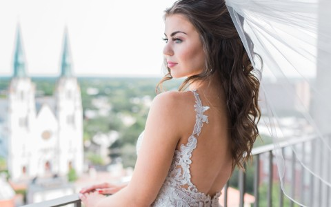 bride looking outside balcony
