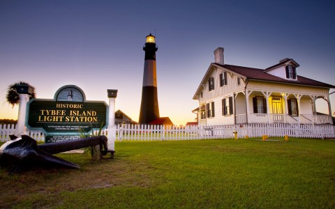 lighthouse with a sign that says tybee island