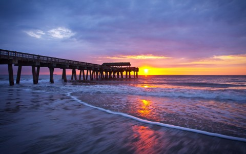 beach shore and pier during sunset