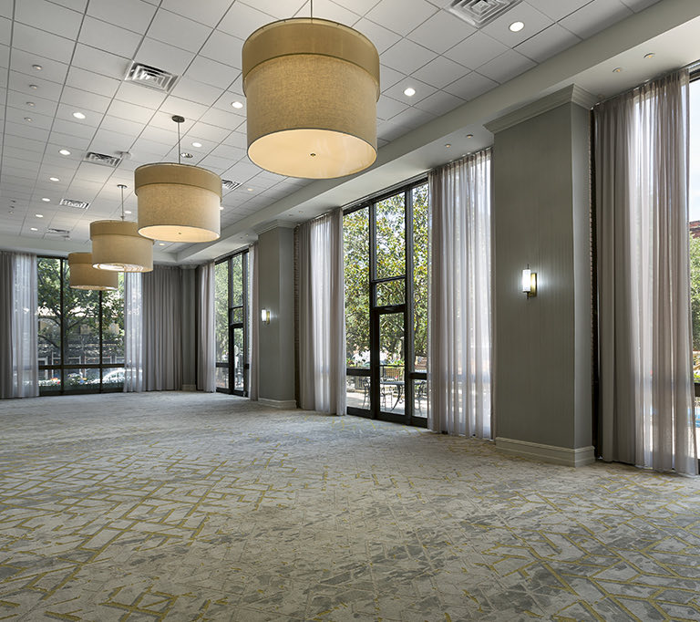 meeting space with lots of windows and rows of chandeliers