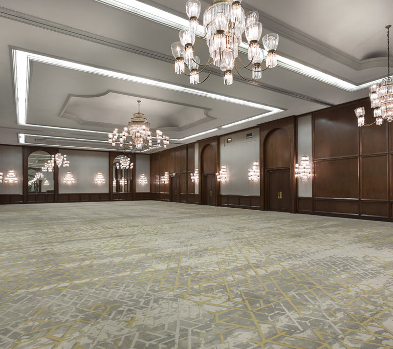 large meeting space with carpet floor and chandelier