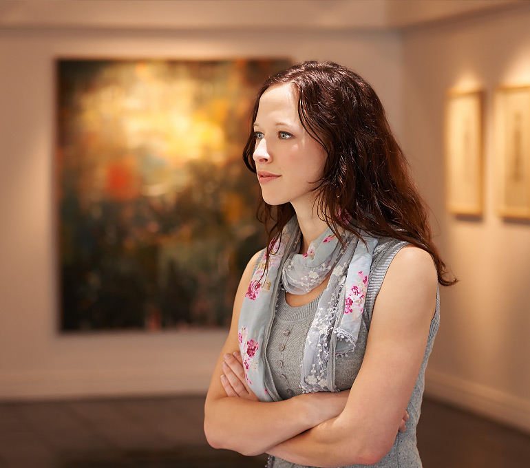 woman focused in on a museum image