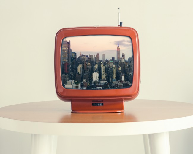 a photo of a retro tv showing nyc skyline