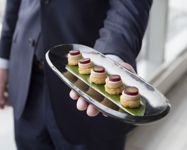 plate of desserts being server by waiter