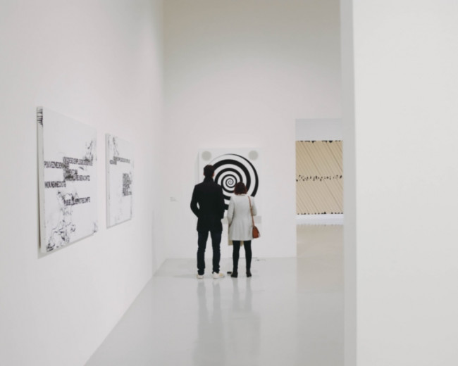 couple standing in art  gallery