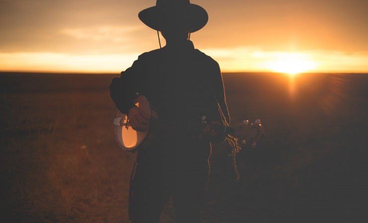 Banjo Player in the Sunset