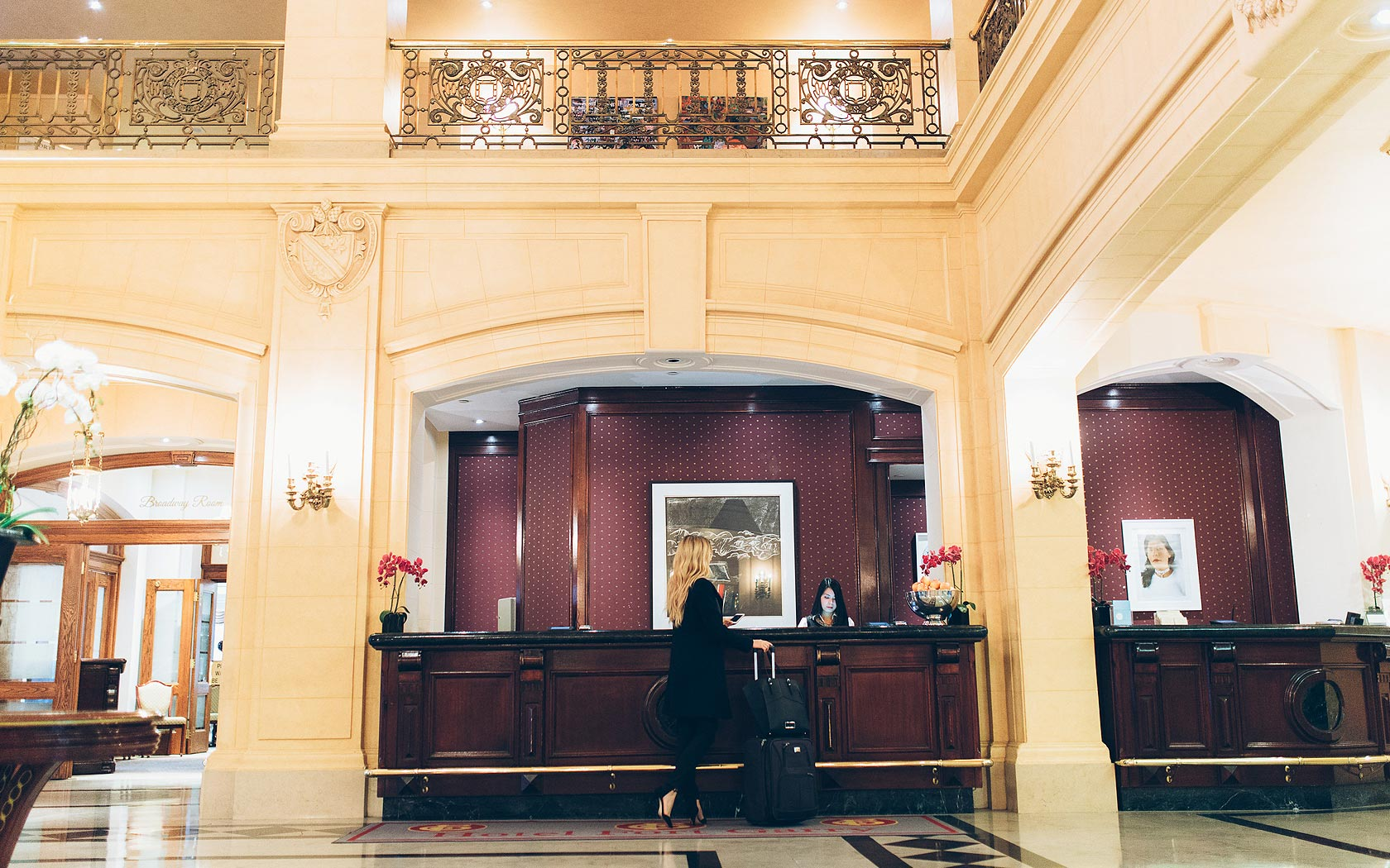 woman checking into hotel at desk