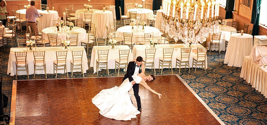 wedding couple dancing in ballroom
