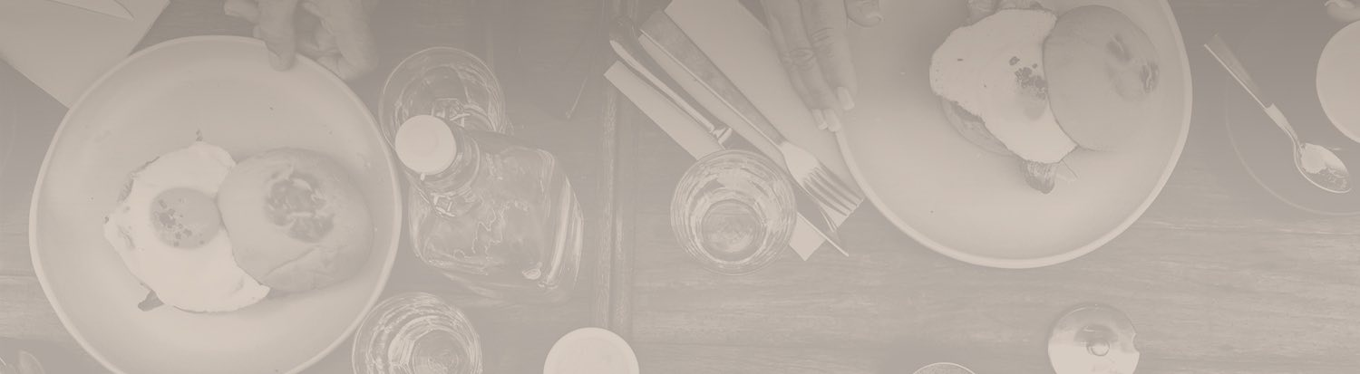 silverware and glass bottle on a wooden table