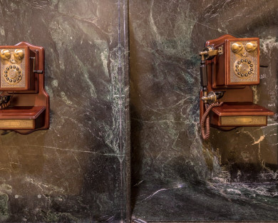 vintage telephone on black marble wall
