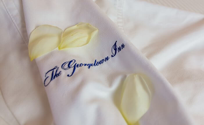 close up of silk robe with Georgetown Inn written on it