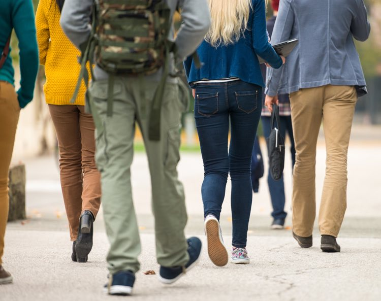 students walking to class wearing casual clothing