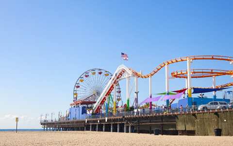 pier with multiple colorful amusement rides