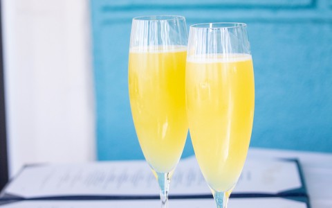 two flutes with mimosas