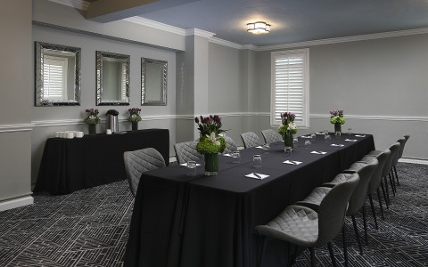 long conference table with dark tablecloths