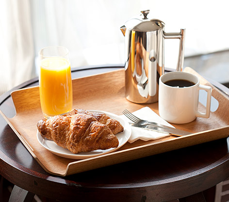 Serving tray with breakfast foods and coffee