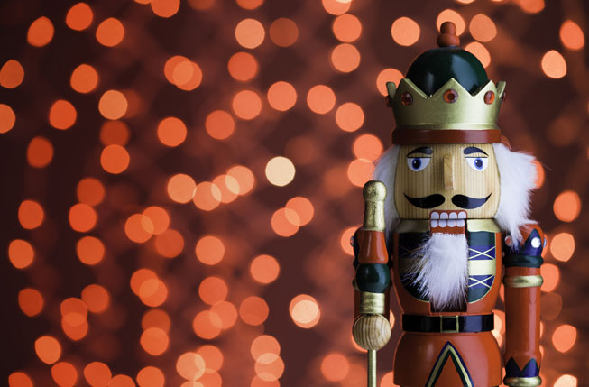 Nutcracker in front of holiday lights