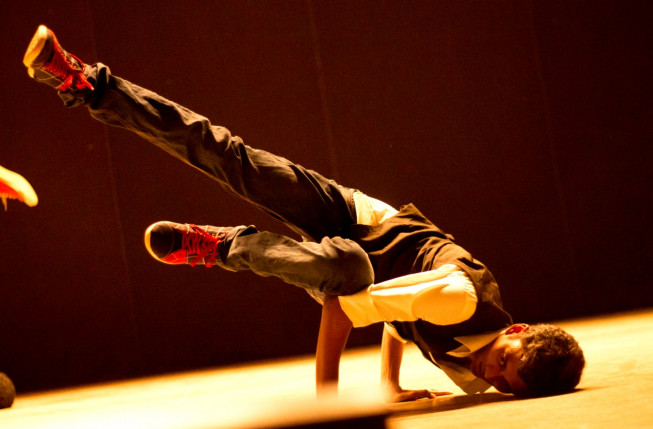 Young man breakdancing on stage