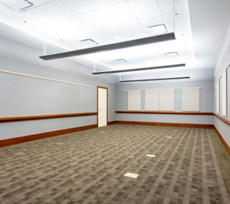 empty conference room with white boards on the wall