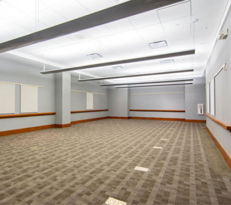 large conference room space with open ceilings and columns