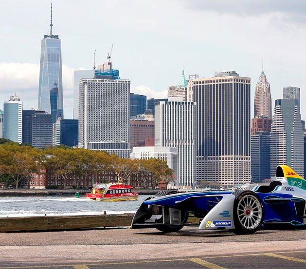 New York City buildings with race car in the foreground
