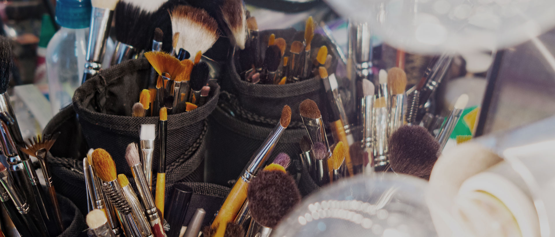 Close up of containers with make up brushes