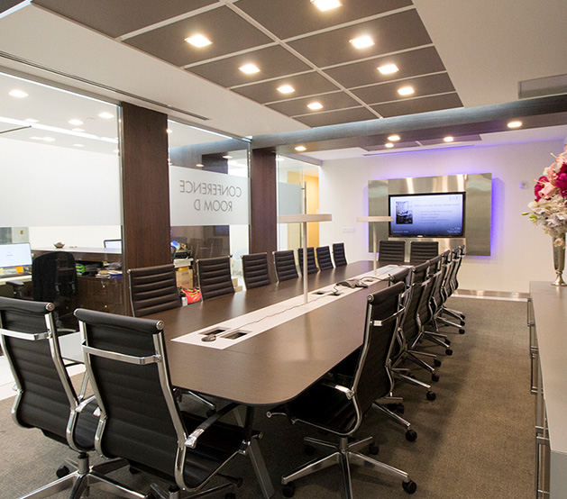Large meeting room with long rectangular table, chairs & Tv