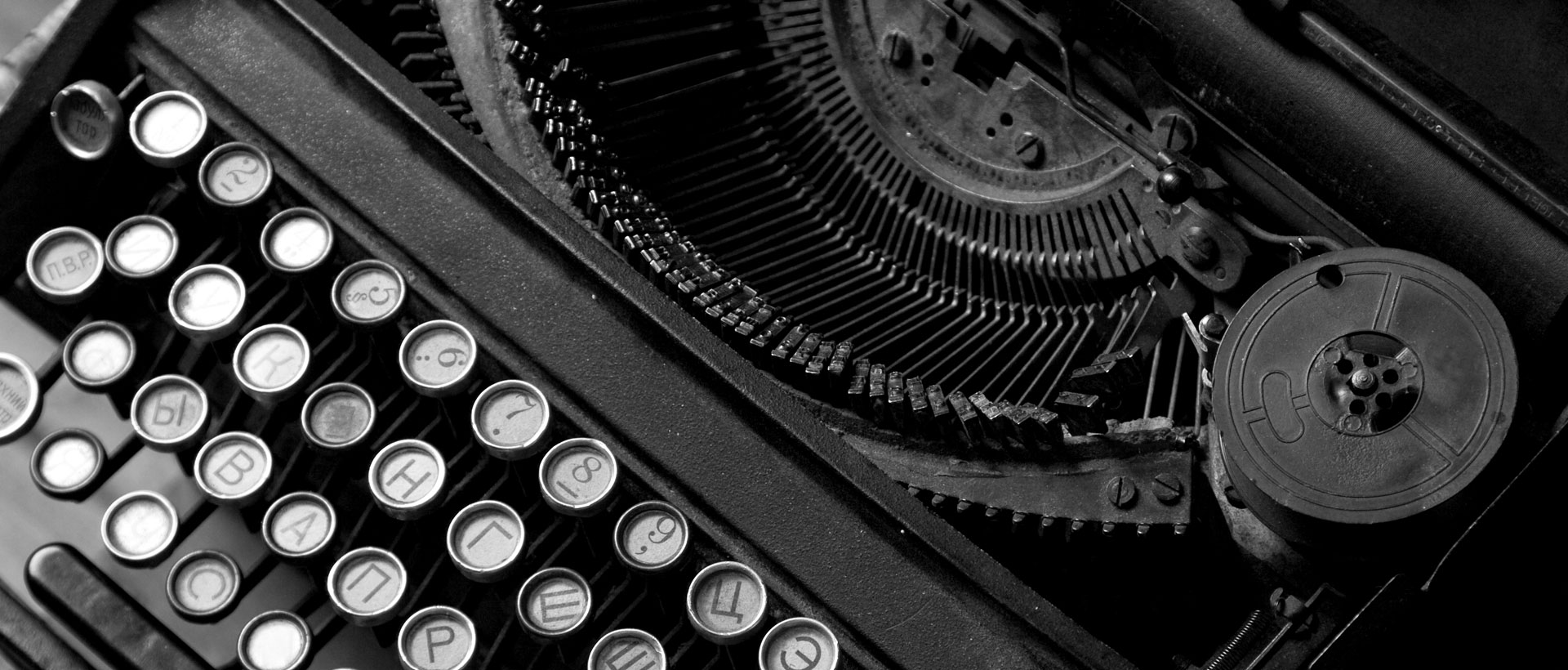 Black & white image of antique typewriter with exposed mechanics