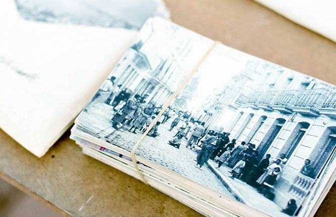 Stack of old postcards bunched together with rubber band