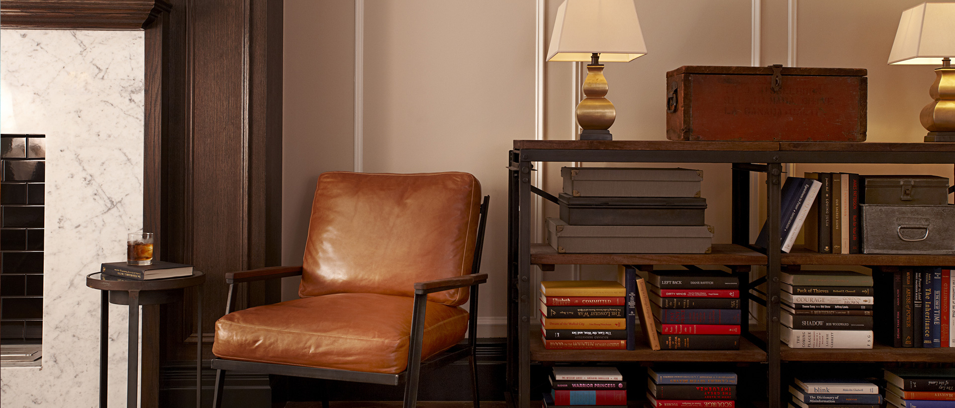 Leather chair next to furniture with stacked books