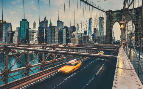 Aerial view of cars crossing Brooklyn bridge