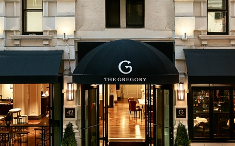 Gregory hotel entrance with black shade & glass doors