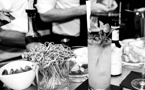 Black & white image of cocktails on table