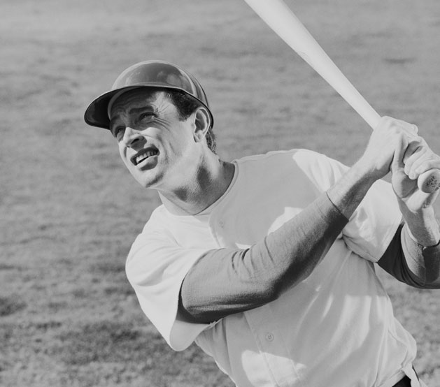 Black & white image of baseball player with bat