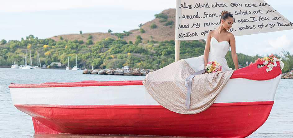 bride on a red and white boat on the water