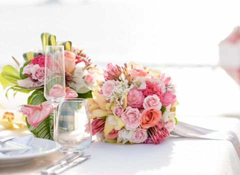 bouquet of flowers on a white table with place settings