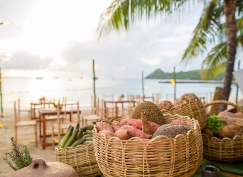 Baskets of food with beach in the background