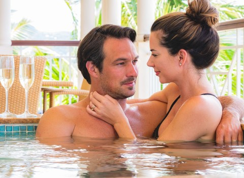 Couple cuddling in a hot tub