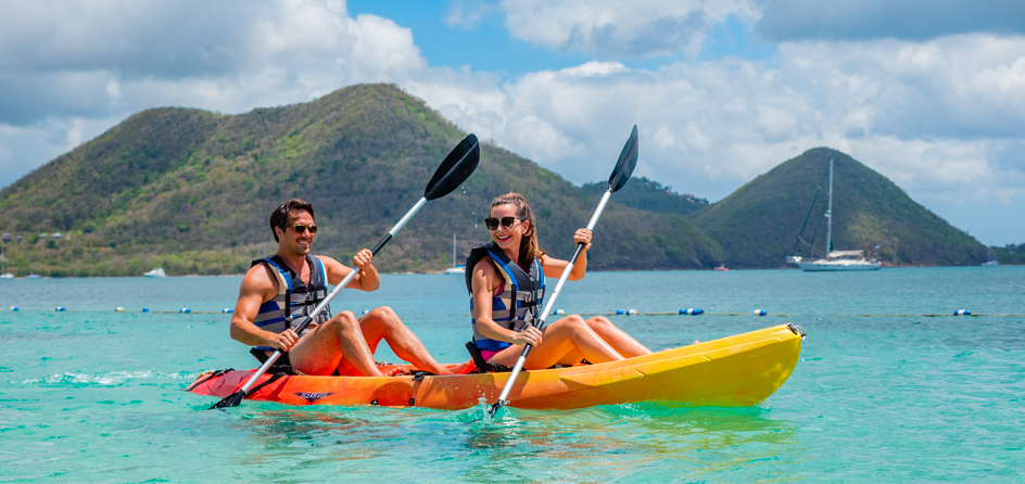 couple kayaking in ocean