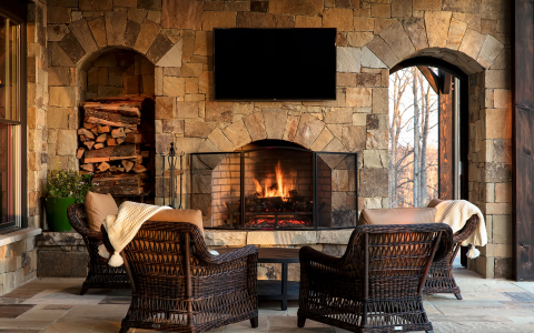 wicker chairs in front of fire pit