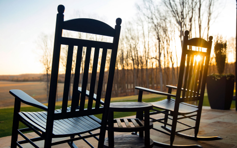 wooden rocking chairs overlooking the sunset