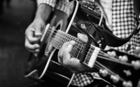 Black & White Photo Titled The Guitar Player by Walid Yassine
