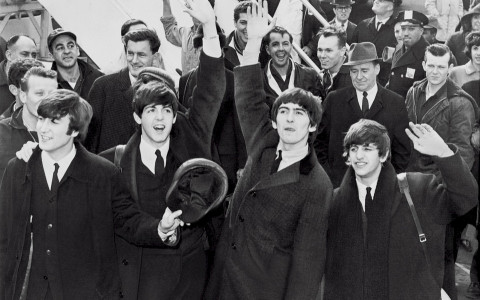 Historic Black  White Photo of the Beatles in Front of a Crowd