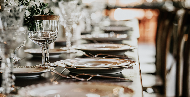 close up view of table settings at a wedding reception table